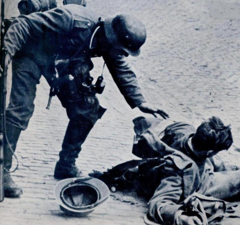German soldier helping a French soldier.jpg