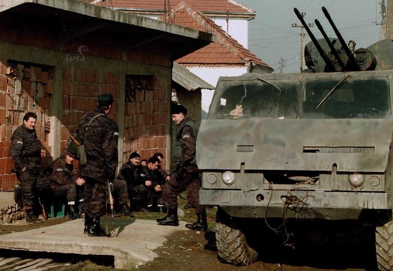 serbian-policemen-wait-for-their-colleag