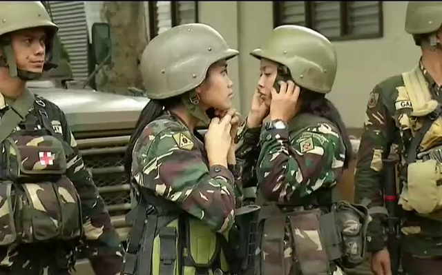 women soldiers AFP (1).png