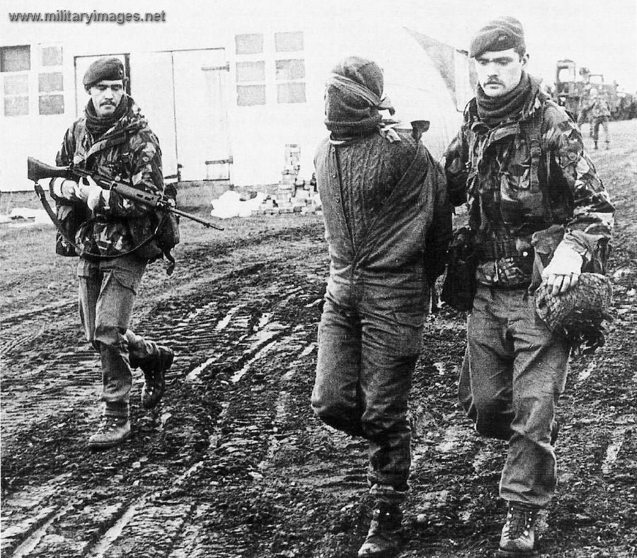 https://www.militaryimages.net/media/argentine-officer-is-escorted-after-being-captured.22349/full?d=1521492992